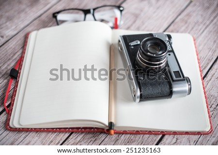 Retro camera and notebook - stock photo