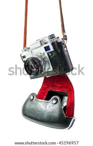 retro camera in red-black case of hanging strap isolated on a white background - stock photo