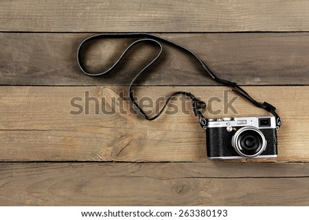 Retro camera on wooden planks background - stock photo
