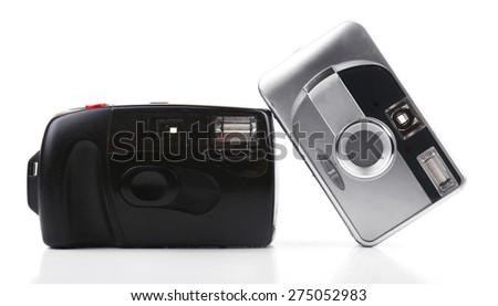 Retro cameras isolated on white - stock photo