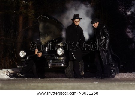 retro car and the man on the road, a car crash - stock photo