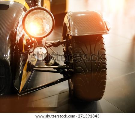 Retro car headlight. Retro postcard of the vintage car - stock photo