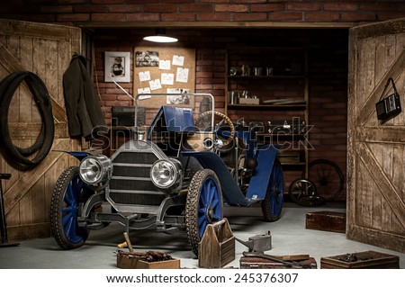 Retro car in the garage for repairs on a summer evening - stock photo