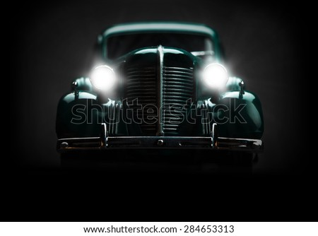 retro car with included lights on a dark background - stock photo