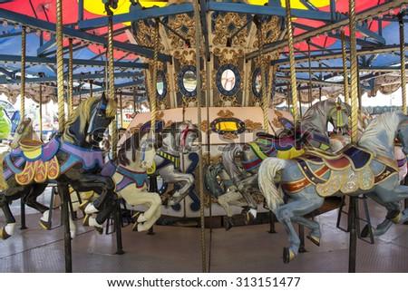 Retro Carnival Carousel Horses - stock photo