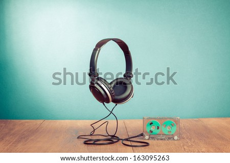 Retro cassette and headphones conceptual photo - stock photo