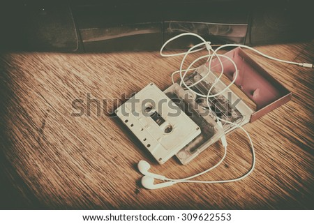 Retro cassette tape and player.Vintage effected photo - stock photo