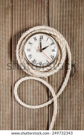 Retro clock on a wooden background - stock photo