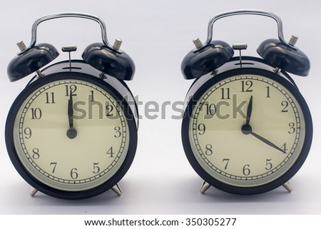 Retro clock on wooden texture front dark blue wall background. Vintage effect. 20 minutes - stock photo