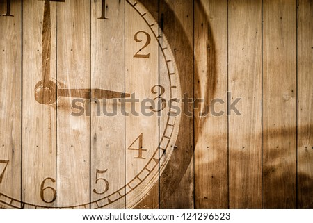 retro closeup clock face on wood background selective focus at number 3 o'clock. - stock photo
