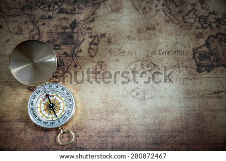 Retro compass on ancient world map, vintage style  - stock photo