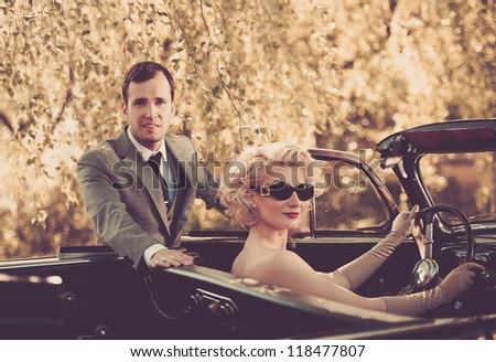 Retro couple and convertible - stock photo