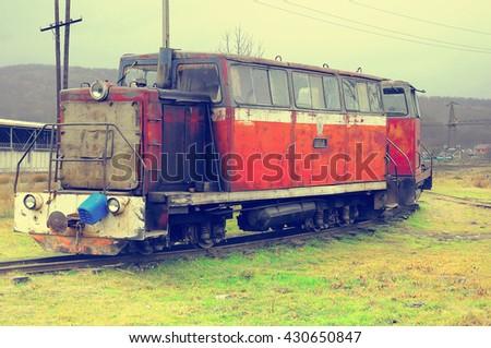 Retro diesel locomotives of narrow gauge stand on Chernigovslaja station. Caucasus. Russia. - stock photo