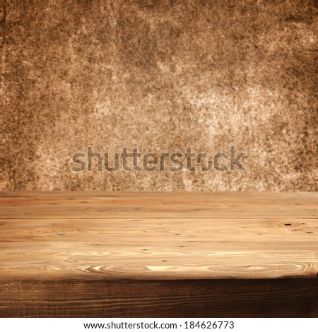 retro dirty wall and wooden desk of brown  - stock photo