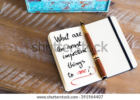 Retro effect and toned image of a fountain pen on a notebook. Handwritten text What Are The Most Important Things To Me ? as business concept image - stock photo