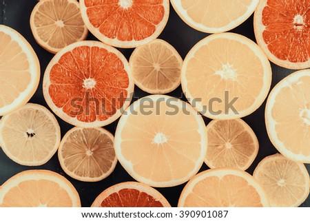 Retro Effect Of Orange, Grapefruit And Lemon Citrus Fruit Slices - stock photo