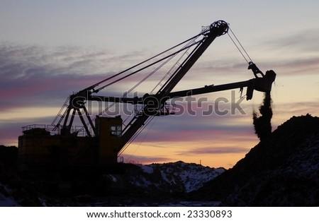 Retro excavator in open cast mining quarry - stock photo