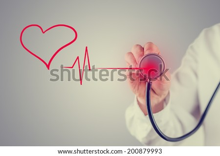 Retro faded effect image of a healthy heart and cardiology concept with a hand-drawn red heart linked to the disc of a stethoscope by a heartbeat tracing as a doctor listens to the sound. - stock photo