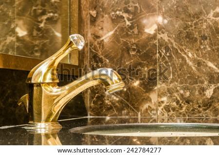 Retro faucet in gold - stock photo
