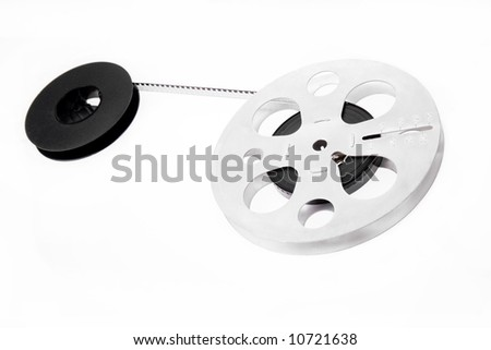 Retro film reels isolated on white background - stock photo