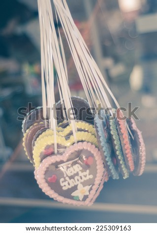 """Retro Filter Heart Shaped Gingerbread Cookies For Oktoberfest Saying """"My Treasure"""" - stock photo"""