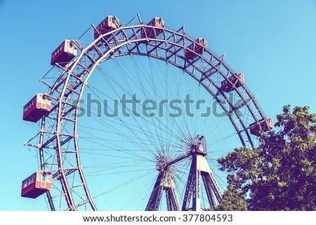 Retro Filter Of Fun Park Ferris Wheel In Prater Park Of Vienna - stock photo