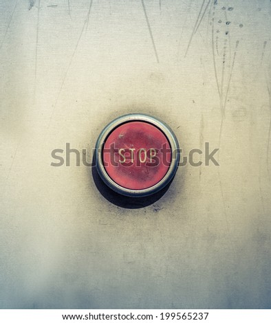 Retro Filtered Concept Photo Of A Red Emergency Stop Button - stock photo