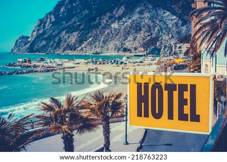 Retro Filtered Photo Of A Vintage Beach Hotel Sign - stock photo