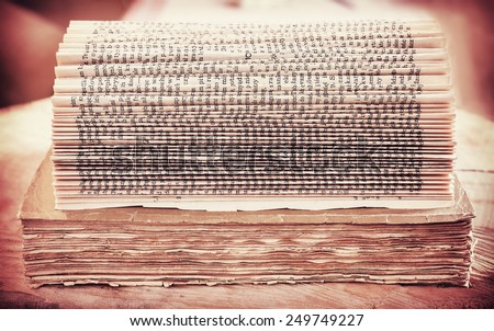 Retro filtered picture of an open book background.  - stock photo