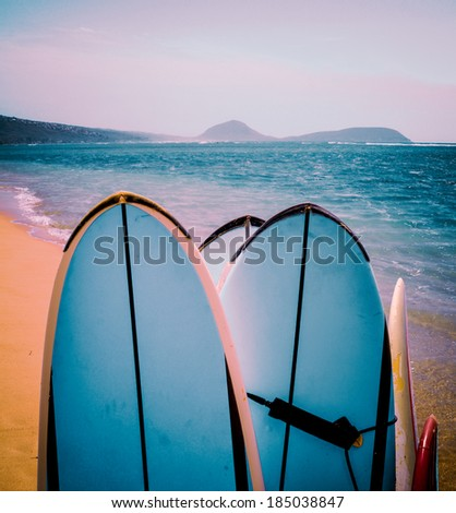 Retro FIltered Surfboards On A Beautiful Hawaiian Beach - stock photo