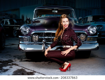 Retro girl sitting in a car - stock photo