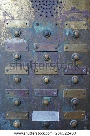 retro grungy apartment doorbell buzzer intercom with blank name plates - stock photo