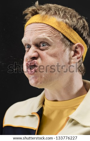 Retro Gym Yelling At His Team With Spit Flying Out Of His Mouth - stock photo