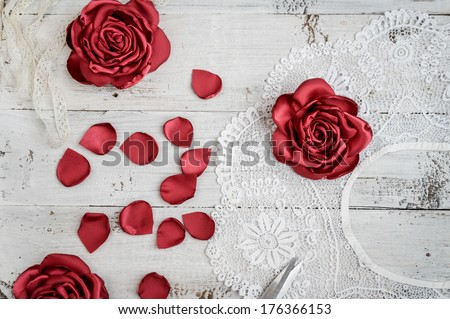 Retro handmade flowers on white old wooden background. shabby chic - stock photo