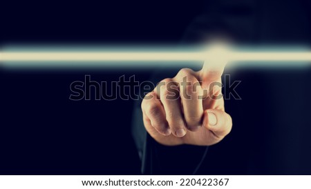 Retro image of a highlighted navigation bar on a virtual screen or computer interface with a man activating it from behind, empty space ready for your text. - stock photo