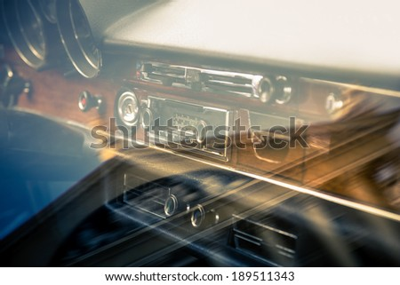 Retro interior of old automobile with reflection - stock photo
