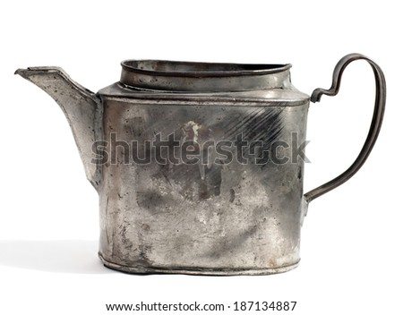 retro kettle with scratches on the white background - stock photo