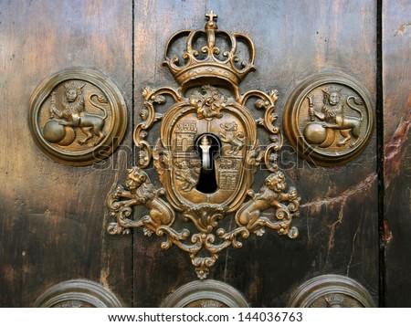 Retro keyhole on the old wooden doors - stock photo