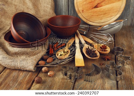 Retro kitchen utensils for baking on rustic wooden background - stock photo