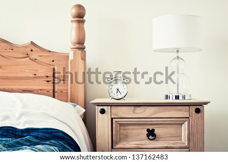 Retro look pine bedroom - stock photo