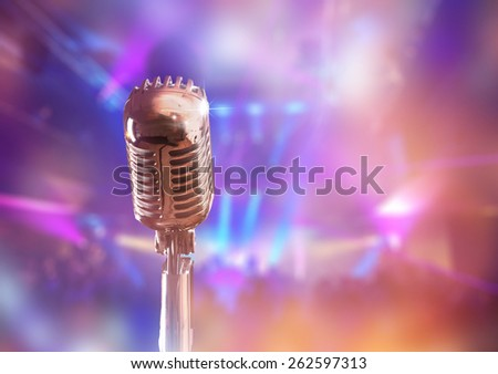 Retro microphone against colorful background - stock photo
