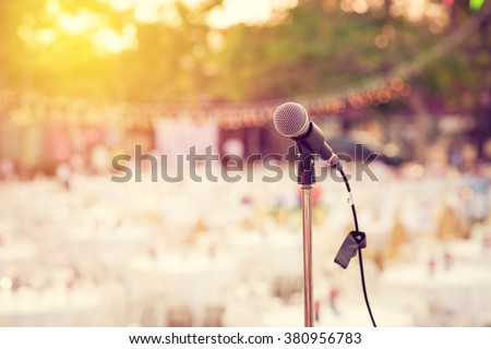 Retro microphone for outdoor concert party. Vintage filter. - stock photo