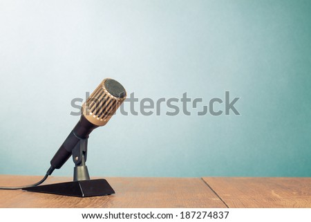 Retro microphone on table - stock photo