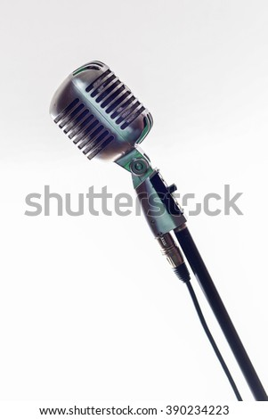 retro microphone on white background - stock photo