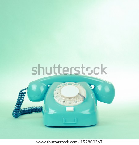 Retro mint green telephone photo with empty place for text - stock photo