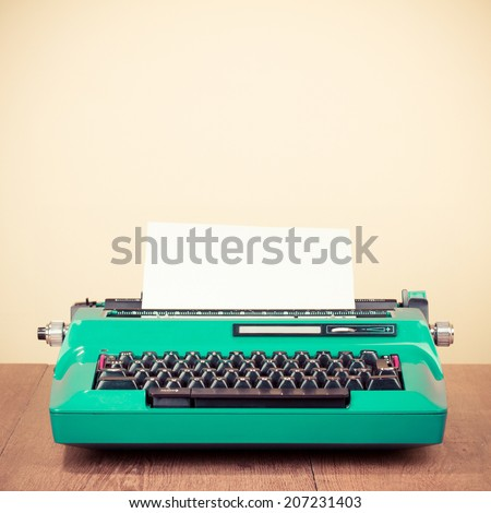 Retro mint green typewriter on table - stock photo
