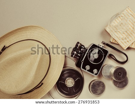 Retro movie camera. May be used as background - stock photo
