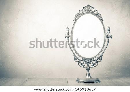 Retro old desk mirror frame. Vintage style sepia photo - stock photo