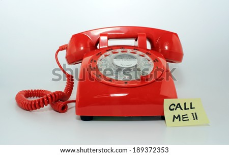 retro old fashion rotary dial phone closed with the memo call me  - stock photo