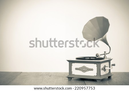 Retro old gramophone radio receiver. Vintage sepia photo - stock photo